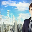 Businessman against cityscape — Stock Photo