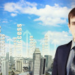 Businessman against cityscape — Stock Photo #16358963