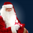 Santa claus with his gift bag - Stock Photo