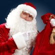Santa claus with his gift bag — Stock Photo #16359767