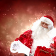 Santa with christmas letter - Stock Photo