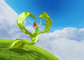 Female dancer and heart symbol — Stock Photo