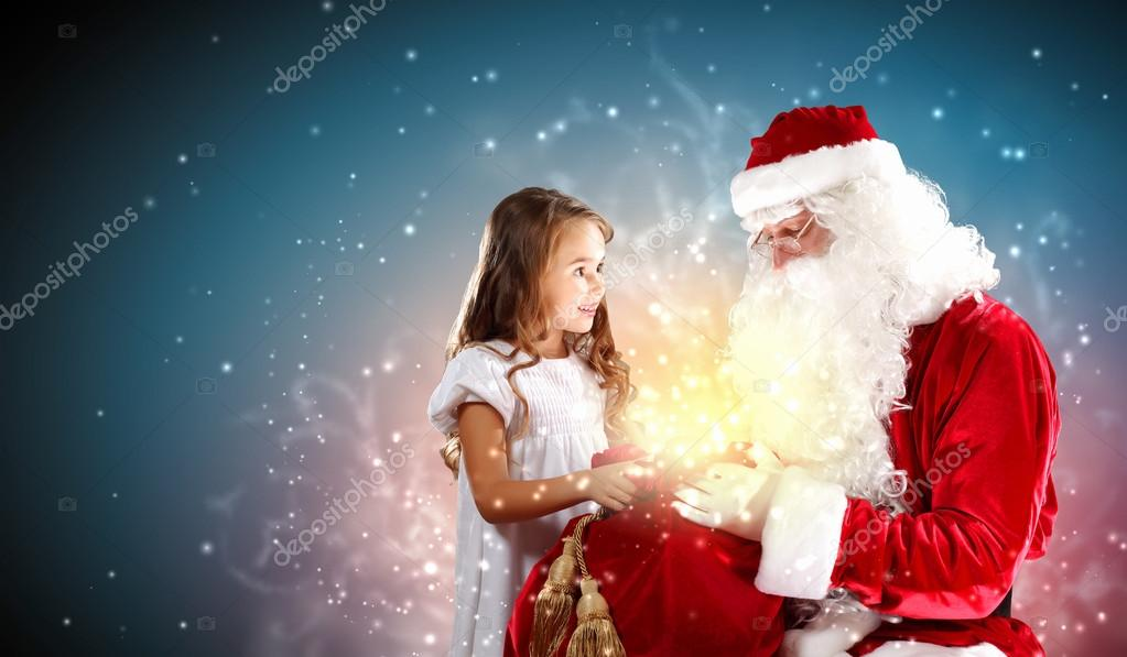 Portrait of Santa Claus with a little girl looking at a gift — Stock Photo #16358379