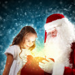 Portrait of santa claus with a girl — Stock Photo #16360891