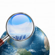 Conceptual mini planet with a city on it — Stock Photo #16361393