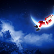 Photo of santa claus sitting on the moon — Stock Photo #16362377