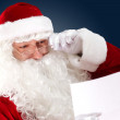Santa claus reading a letter — Stock Photo #16362397