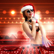 Female dj in christmas wear — Stock Photo #16362737