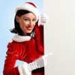 Santa girl with a blank banner — Stock Photo