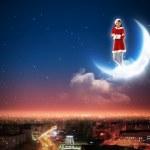 Santa girl on the moon — Stock Photo
