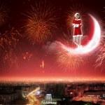 Santa girl on the moon — Stock Photo #16364573