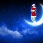 Photo of santa girl sitting on the moon — Stock Photo #16364577