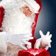 Santa claus reading a letter — Stock Photo #16364789