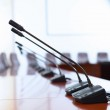 Conference hall with microphones — Stock Photo #16366237