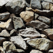 Natural pattern of a stone wall - Stock Photo