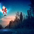 Photo of santa claus sitting on the moon - Foto Stock