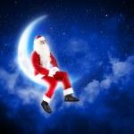 Photo of santa claus sitting on the moon — Stock Photo #16366869
