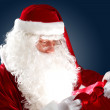 Santa claus with his gift bag — Stock Photo #16366967