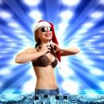 Female dj in christmas wear — Stock Photo #16367617
