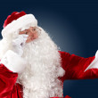 Santa claus reading a letter — Stock Photo #16367951