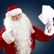 Stock Photo: Santa claus reading a letter
