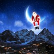 Photo of santa claus sitting on the moon — Stock Photo #16368601
