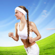 Young pretty woman in sport wear running — Stock Photo #16368659