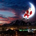 Photo of santa claus sitting on the moon — Stock Photo #16369975