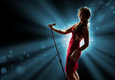 Female singer on the stage — Stock Photo