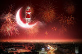 Santa girl on the moon — Stock Photo