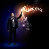 Businessman with light shining — Stock Photo