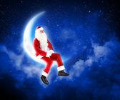 Ay'da oturup noel baba'nın fotoğraf — Stok fotoğraf