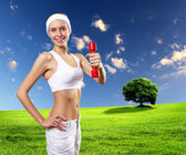 Woman in sport wear doing exercise — Stock Photo