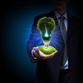 Clean energy. green light bulb — Stock Photo