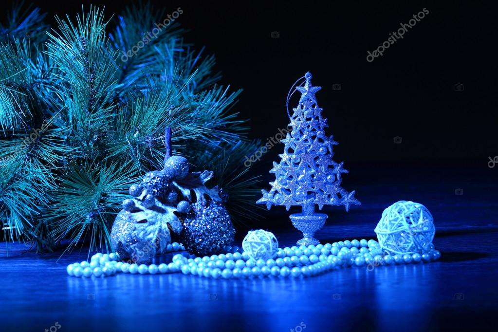 Beautiful Decorated Christmas tree on a darl background — Stock Photo #16364295