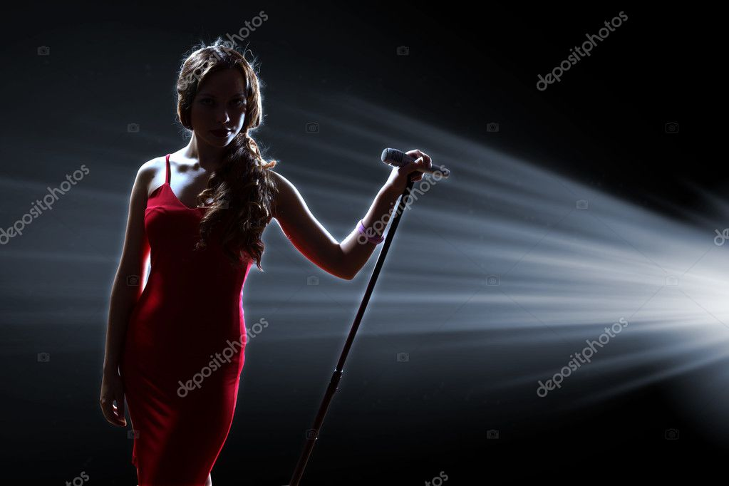 Female singer on the stage — Stock Photo © SergeyNivens ...