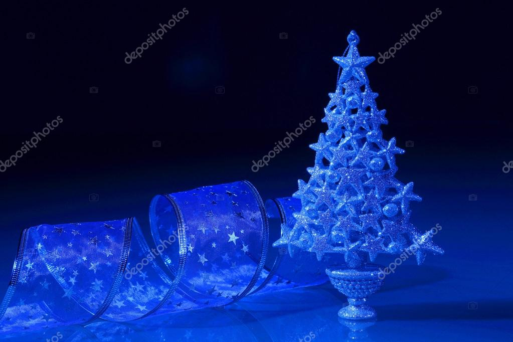 Beautiful Decorated Christmas tree on a darl background — Stock Photo #16368791