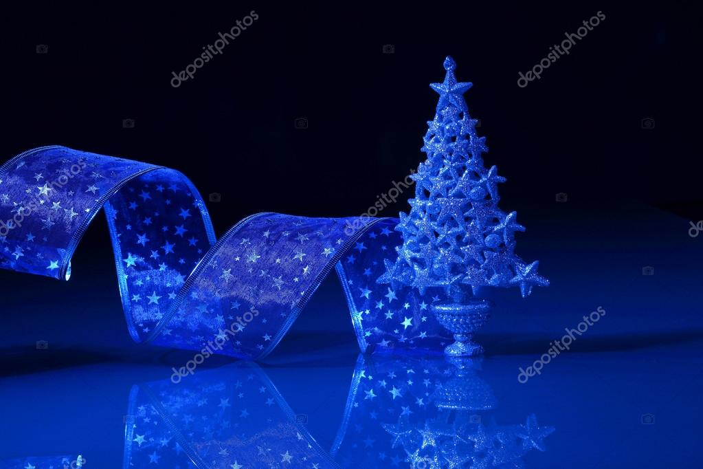 Beautiful Decorated Christmas tree on a darl background — Stock Photo #16369621