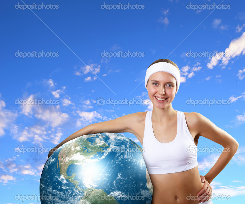Young woman in sport wear with a model of our planet. Elements of this image are furnishes by NASA — Stock Photo #16369917