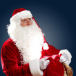 Santa claus with his gift bag — Stock Photo