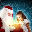 Portrait of santa claus with a girl — Stock Photo #16374237