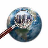 Conceptual mini planet with a city on it — Stock Photo