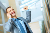 Portrait of happy smiling young businesman — Stock Photo