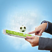 Touch screen computer device and ball — Stock Photo