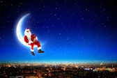 Santa on the moon — 图库照片