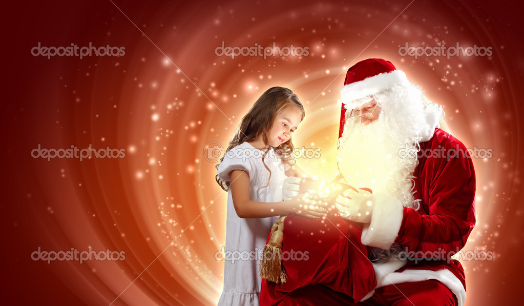 Portrait of Santa Claus with a little girl looking at a gift — Stock Photo #16372029