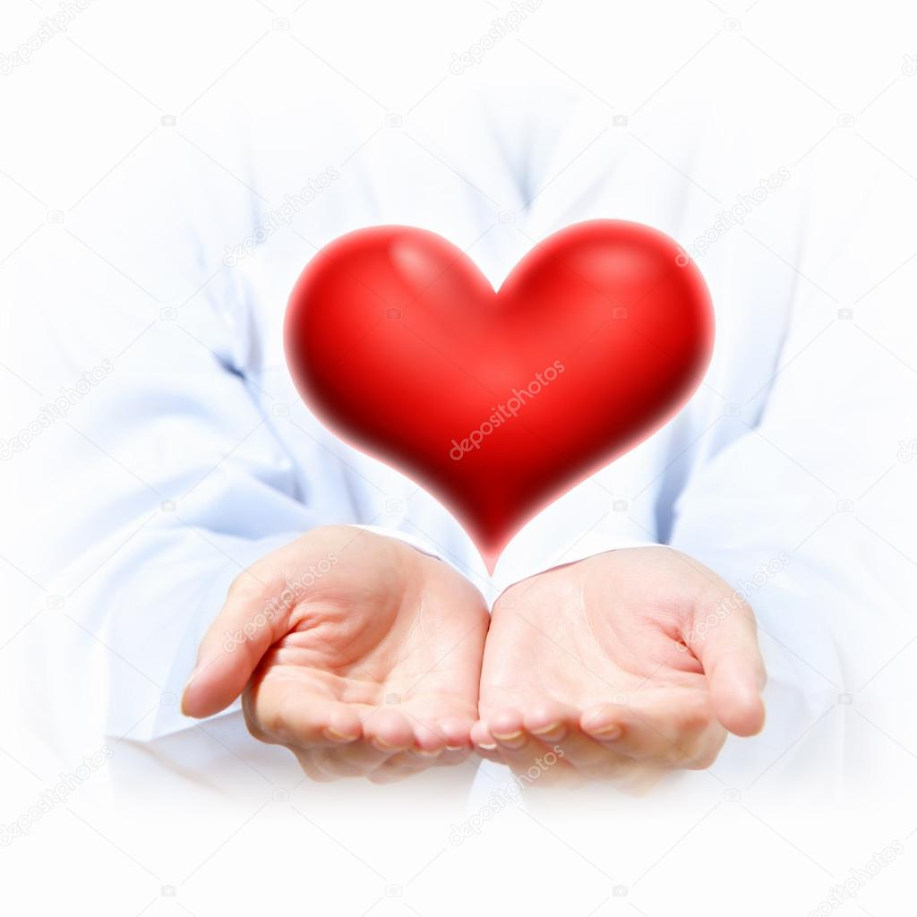 A Big Red Heart in thehand of a person — Stock Photo #16372541