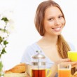Beautiful young woman drinking tea from yellow cup — Stock Photo #19580735