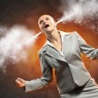 Businesswoman in anger screaming steam going out from ears — Stock Photo