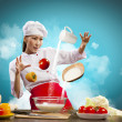 Asian female cooking with magic against color background — Stock Photo #19581315